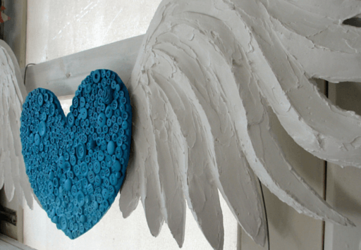 This DIY Heart with Wings is made from cardboard + buttons + plaster, and is ridiculously easy to replicate  |  check out the tutorial at Purple Paper House dot com dot au